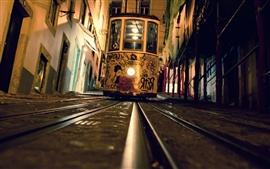 Preview wallpaper Tram, front view, night, rails, city