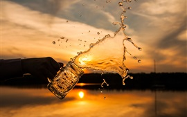 Preview wallpaper Water splash, glass cup, sunset