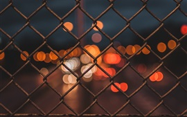 Wire fence, glare, night