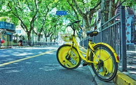 Preview wallpaper Yellow bike, road, street, city