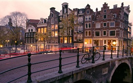 Preview wallpaper Amsterdam, Nederland, city, houses, bridge, lights, dusk