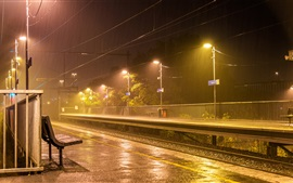 Preview wallpaper Australia, Melbourne, railroad, lights, platform, raining, night