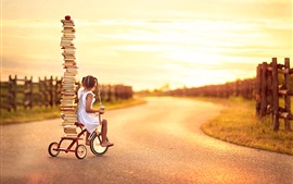 Preview wallpaper Child girl, little bike, many books