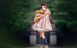 Preview wallpaper Cute child girl hugging teddy