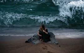 Girl sit at beach, sea waves