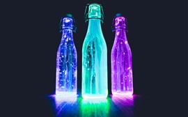 Glow light bottles, néon, líquido, fundo preto