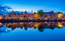 Haarlem, Netherlands, Spaarne river, city, dusk, lights, houses, reflection