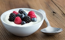 Milk, berries, spoon