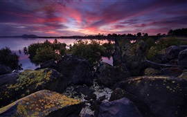 Preview wallpaper New Zealand, rocks, river, clouds, red sky, dusk
