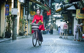 Preview wallpaper Red dress Asian girl ride bike at street