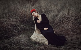 Preview wallpaper Sadness girl, black dress, flowers, grass