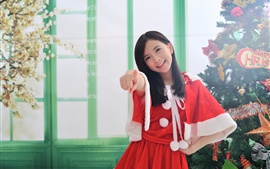 Preview wallpaper Smile Asian girl, Christmas, red dress, finger