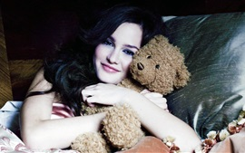 Smile girl hugging teddy bear