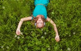 Preview wallpaper Smile girl, listen music, lying on grass