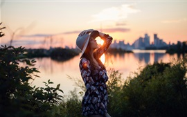 Sunset, girl, hat, river, city