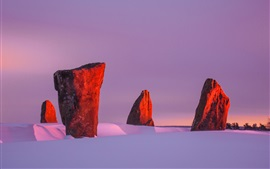 Preview wallpaper Winter, snow, megaliths, sunset