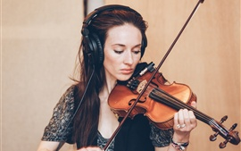 A woman playing violin, music, headphone