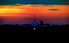 Preview wallpaper Airplane at sunset, front view, night
