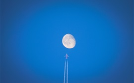 Preview wallpaper Airplane flight to the moon, blue sky