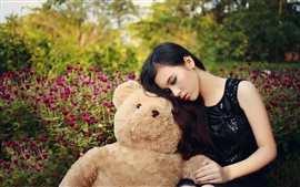 Preview wallpaper Asian girl and teddy bear, sadness