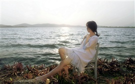 Preview wallpaper Asian girl look at sea, chair, sun