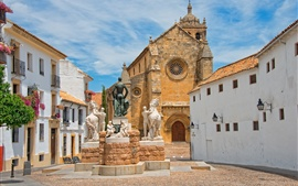 Cordoba, Spain, church, houses, statues, sky