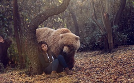 Preview wallpaper Forest, brown bear look at sleeping girl