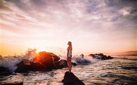 Girl, sea, stones, waves, sunset