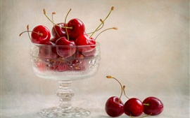 Glass cup, red cherries