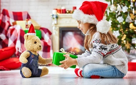 Happy child girl and teddy bear, gift, Christmas
