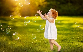 Preview wallpaper Happy child, girl play bubbles, summer, grass