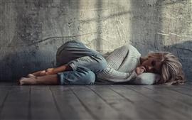 Sadness blonde girl, sleep on floor