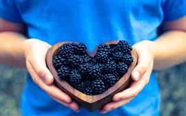 Blackberries, love heart, hands