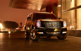 Cadillac SUV car at night