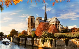 Cathedral, river, boats, autumn