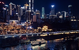 Preview wallpaper Chongqing, China, city, night, skyscrapers, lights, river, boats, blurry
