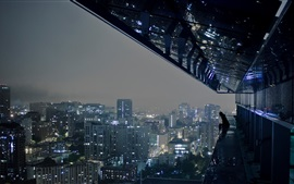 City, buildings, night, roof, person