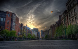 Preview wallpaper City, road, houses, buildings, lamps, dusk, sunset
