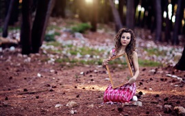 Curly hair girl sit on ground, mirror