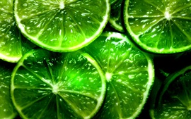 Preview wallpaper Green lemon slices, fruit close-up