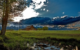 House, trees, grass, mountains, clouds, sun rays