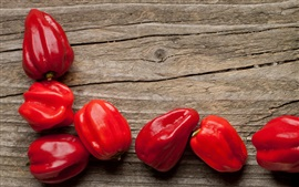 Red peppers, wood background, vegetables