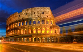 Roman colosseum night view, lights, road