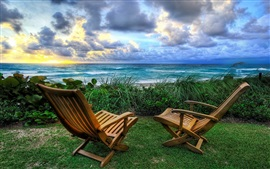 Preview wallpaper Sea, clouds, sunrise, grass, chairs