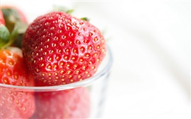 Strawberries, glass cup, white background