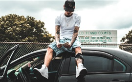Preview wallpaper Tattoos guy sit on car top