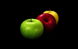 Preview wallpaper Three apples, green, red, yellow, black background