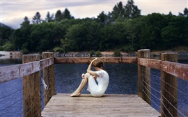 Preview wallpaper White skirt girl sit on the wood bridge, lake