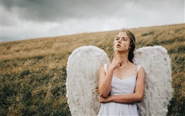 Preview wallpaper Angel girl, wings, grass, wind