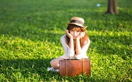 Preview wallpaper Asian girl, hat, suitcase, grass, sunshine